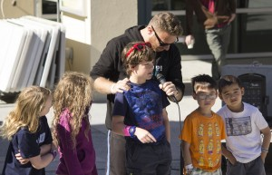 Shai holds a microphone to OFJCC J-Campers