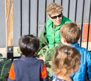 Teacher Debbie in the Leslie Family Preschool Garden.