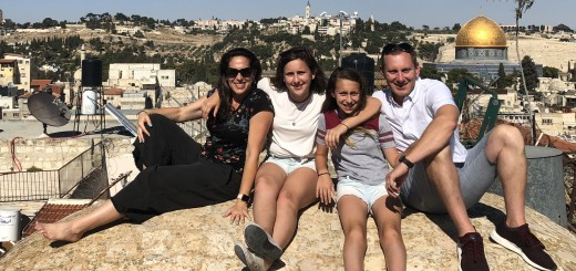 Julie, her daughters and husband Ed on a rooftop in Jerusalem