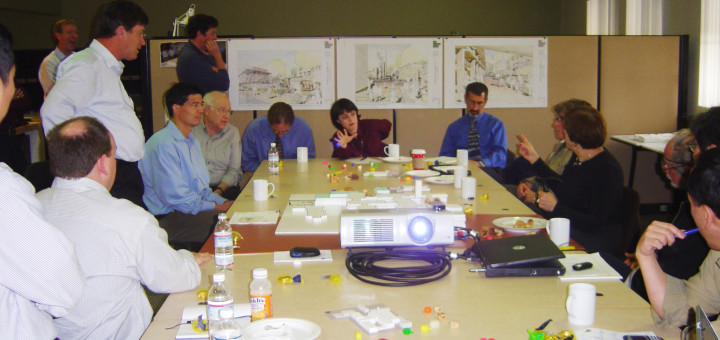 JCC leadership planning the new campus (with dreidels on the table) circa 2007.