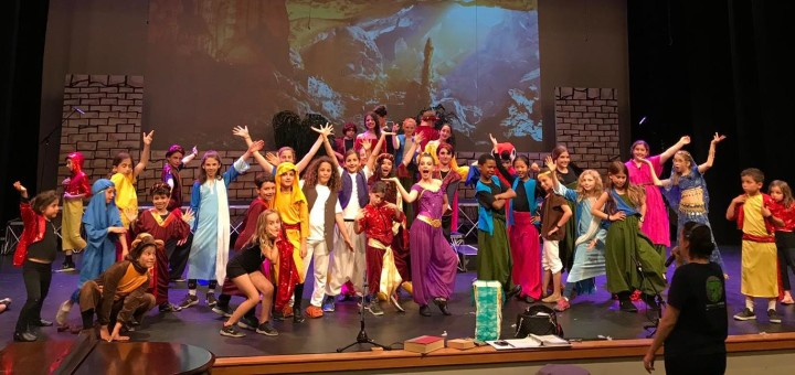 Yuval (sixth from left, in burgundy hat) was the youngest cast member in the OFJCC production of Disney's Aladdin JR.