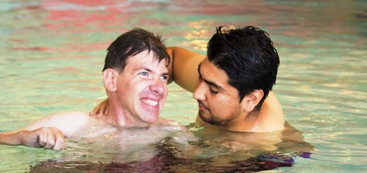 Abilities United participant John Pappas enjoys the OFJCC pool with assistance from Community Training Instructor Moises Acuña.