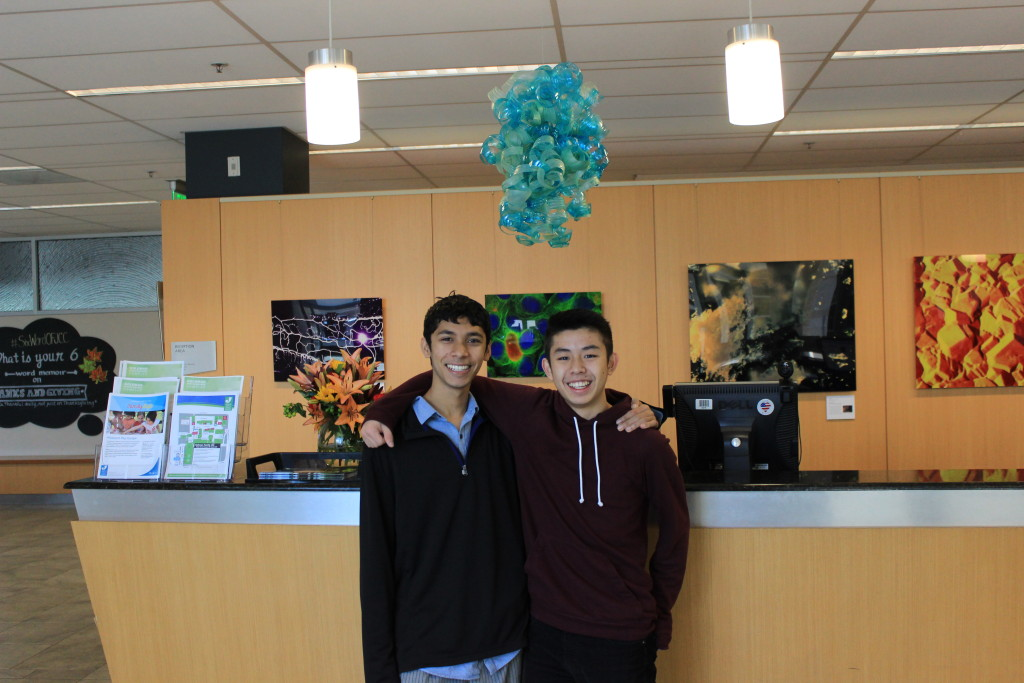 Gunn High School students Keshav Nand and Jerry Liu in front of their Idea Challenge creation.