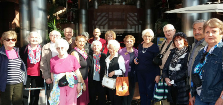 Seniors at Blackhawk Museum with Jo Kadis, center, in purple